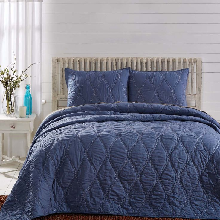 FREE SHIPPING  ::  For a truly understated coastal look, the Harbour Navy Quilt features hand-quilted contrasting creme ogee pattern on smoky blue cotton cambric. The sea-inspired quilting pattern mimics waves for a home retreat. Reverses to solid smoky blue.