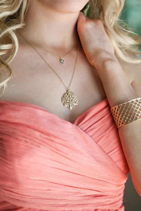 Gold jewelry with coral dress
