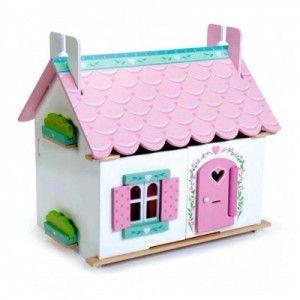ΞΥΛΙΝΟ ΚΟΥΚΛΟΣΠΙΤΟ LILLY'S Είναι ένα όμορφο ξύλινο σπίτι ζωγραφισμένο μέσα και έξω, με μοτίβο λουλουδιών, με παράθυρα, πόρτα, σκεπή και πρόσοψη που ανοίγουν για καλύτερη πρόσβαση στα δωμάτιά του. Περιλαμβάνει το σετ των επίπλων του. Οι κούκλες πωλούνται χωριστά.