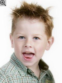 Hairstyle for little boys. Tapering on the sides and in the back and gel styling for a spiky look.