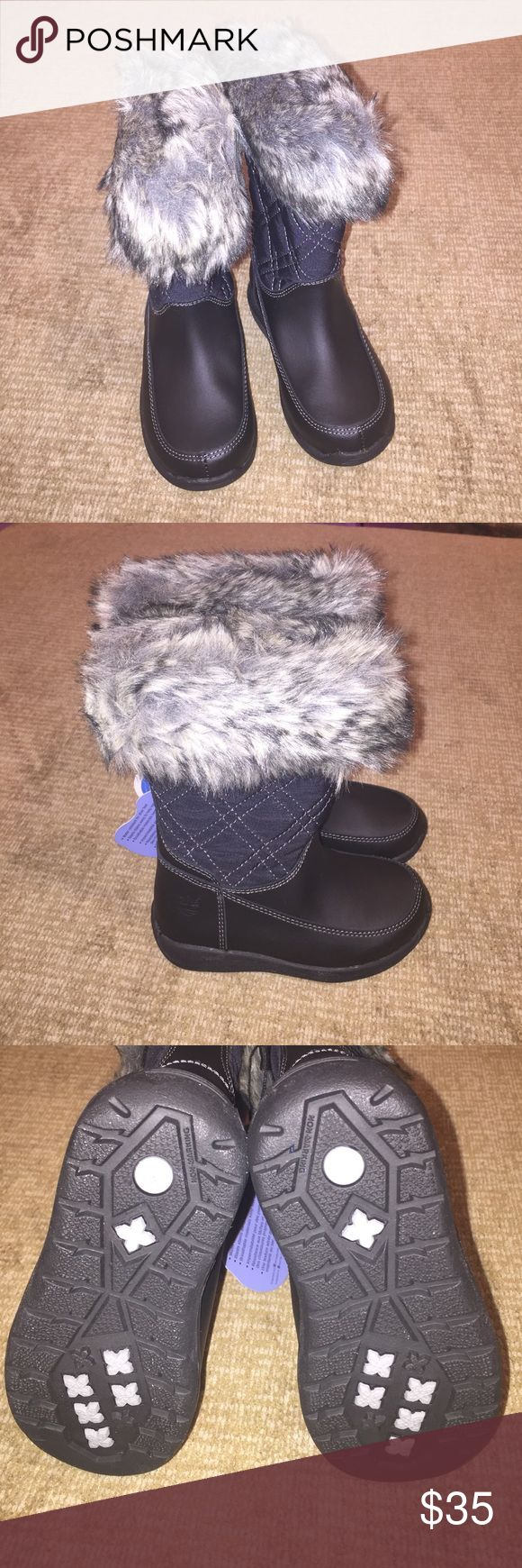 Toddlers Timberland boots Brand New 7.5 toddler Timberland black boots with faux fur grey trim. Water resistant Timberland Shoes Rain & Snow Boots