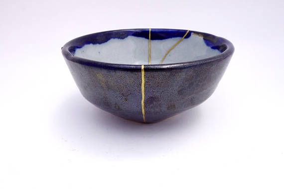 The philosophy behind kintsugi lies in honoring our imperfections. Instead of trying to conceal the damage of a broken ceramic, or even throwing it out altogether, the piece gets mended with a stream of gold. Thus, the break is featured instead of hidden, transforming the damage into its most valuable asset. This shift from useless to priceless makes each piece singularly unique. Given that we each have a past filled with our own stories, this isn't a bad philosophy to live by.  Unlike other…