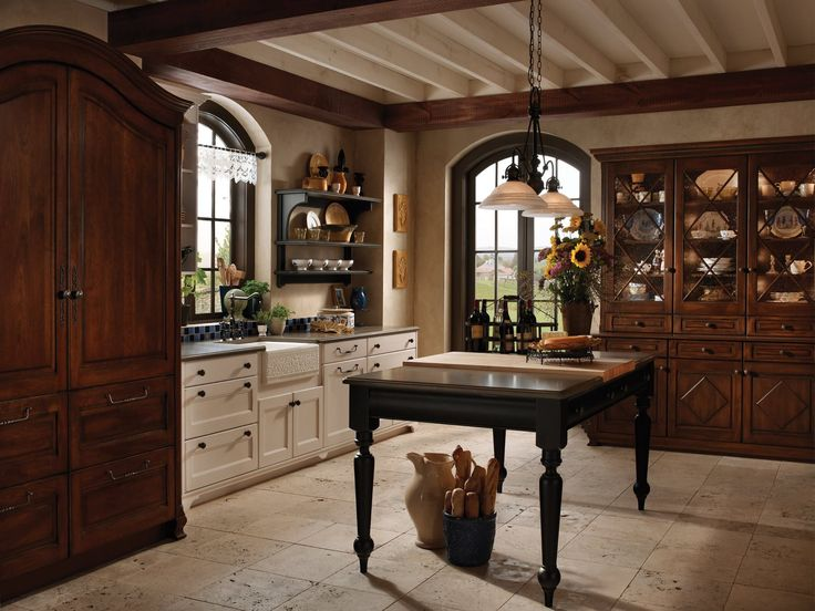 the rich textures and colors in this woodmode kitchen exude an oldstyle