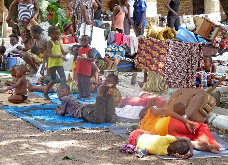 Brazzaville residents camp out in the grounds of a cathedral after they were displaced by a huge explosion at an army barracks in the city on 4 March 2012
