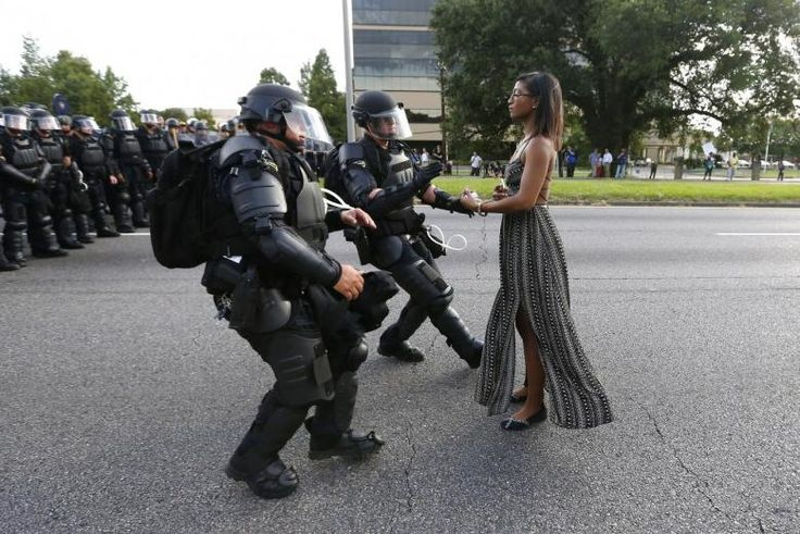 A demonstrator protesting the shooting death of Alton Sterling is detained by law enforcement near the headquarters of the Baton Rouge Police Department in Baton Rouge. REUTERS/Jonathan Bachman
