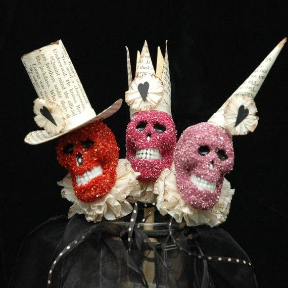 Dollar store skulls, glitter, a book for the hats, crepe paper collar = fab