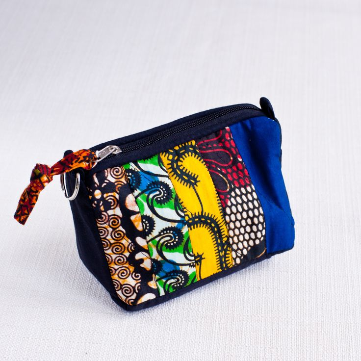 Our Patchwork Cosmetic Case from Uganda features strips of bright African…