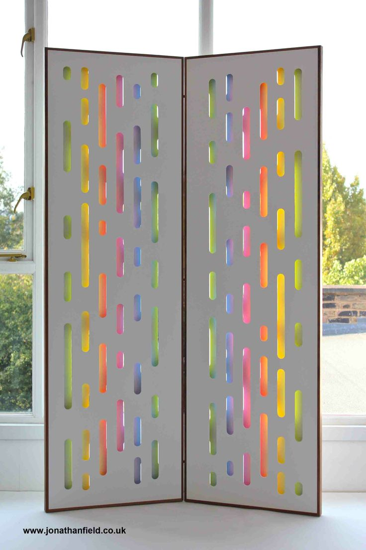 The reflective screens are made to order and can have a mix of different colours or just one or two colours. The screen pictured has five colours giving a rainbow effect. They can be made with different timbers for the frame and also different sizes. 180cm H x 55cm W x 6cm D Price:  £695.00  www.jonathanfield.co.uk