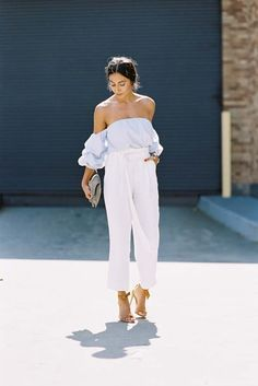 a modern summer outfit with off the shoulder top and white pants