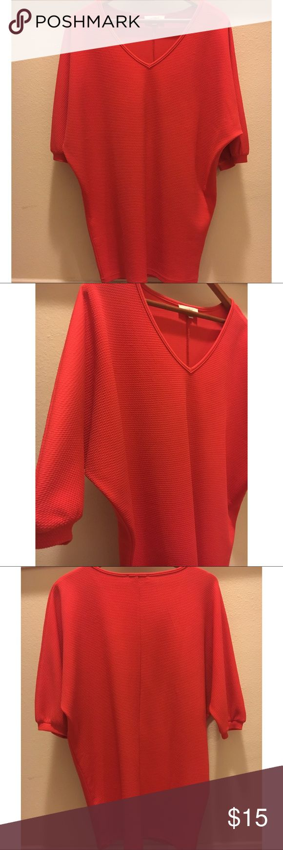 Bright red tunic blouse size small brand new Gorgeous bright red tunic length Blouse  3/4 length sleeves  Hits below waist  Blouson Sleeve style  V neck  Size small  Loose fit  Brand new  Cotton blend  By umgee USA Umgee Tops Blouses