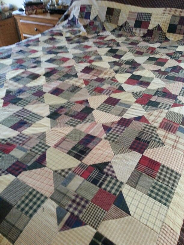 Plaid homespun fabrics.  Quilt made by Lauren Applebee