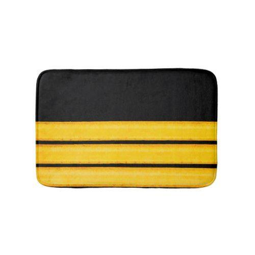 Yellow stripes on black bath mat