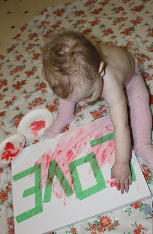 Finger Painting - First put a word/message in tape on the canvas, then let your child finger paint over it. Finally, remove tape.