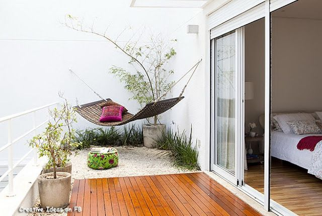 fantastic use of small outdoor space! Deck, dg or pebbles, grasses, container plants, hammock