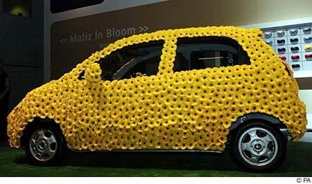 'Car in Bloom' created by celebrity florist Paula Pryke with 2000 yellow Gerberas on Chevrolet Matiz