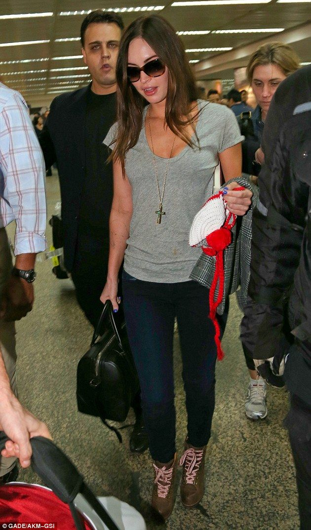 Cute traveling clothes    Glamour girl: Megan Fox looked groomed and gorgeous as she passed through Los Angeles International Airport on Friday with her family