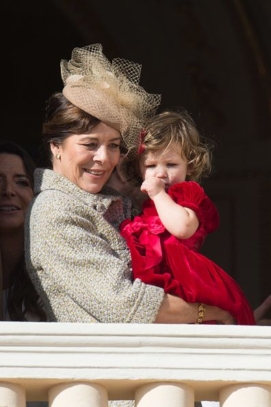 Princess Caroline of Hanover and India Casiraghi greet the crowd from the palace's balcony during the Monaco National Day Celebrations on November 19...