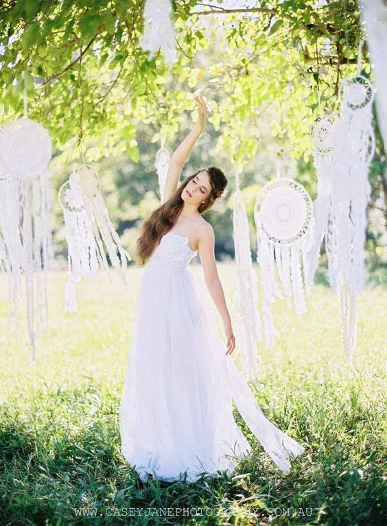 A wedding dream caught amongst the beauty of nature and lace dream catchers.