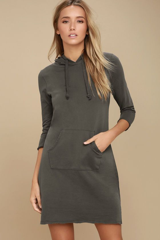 Keep it cool and casual in the Others Follow Cool Waters Charcoal Grey Hoodie Dress! Lightweight knit composes a hooded neckline and three-quarter length sleeves. Wide-cut bodice and shift skirt with front kangaroo pocket finishes this sporty look. Raw edge hem and sleeve cuffs.