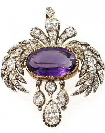 A Georgian amethyst and diamond brooch, the central yellow gold-set oval-shaped faceted amethyst estimated to weigh 10 carats, surmounted by old brilliant-cut diamond-set foliate motifs and pendant loop, suspending pear-shaped diamond drops, total estimated diamond weight 5 carats, all silver cut-down collet-set to a yellow gold mount, gross weight 13.8 grams, circa 1810