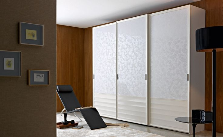 M17 - Mosaico   Contemporary Collections Le Fablier   3-sliding door wardrobe   Measures in cm (LxDxH) 300x62x249   Structure in lime wood   Doors are available in wood, with leather or false leather inserts, with glass or mirrors