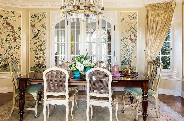 The bespoke wallpaper is the main statement here—all of Bachmann's other choices (the room's pale palette, the elegantly timeworn chairs) allow it catch the eye.