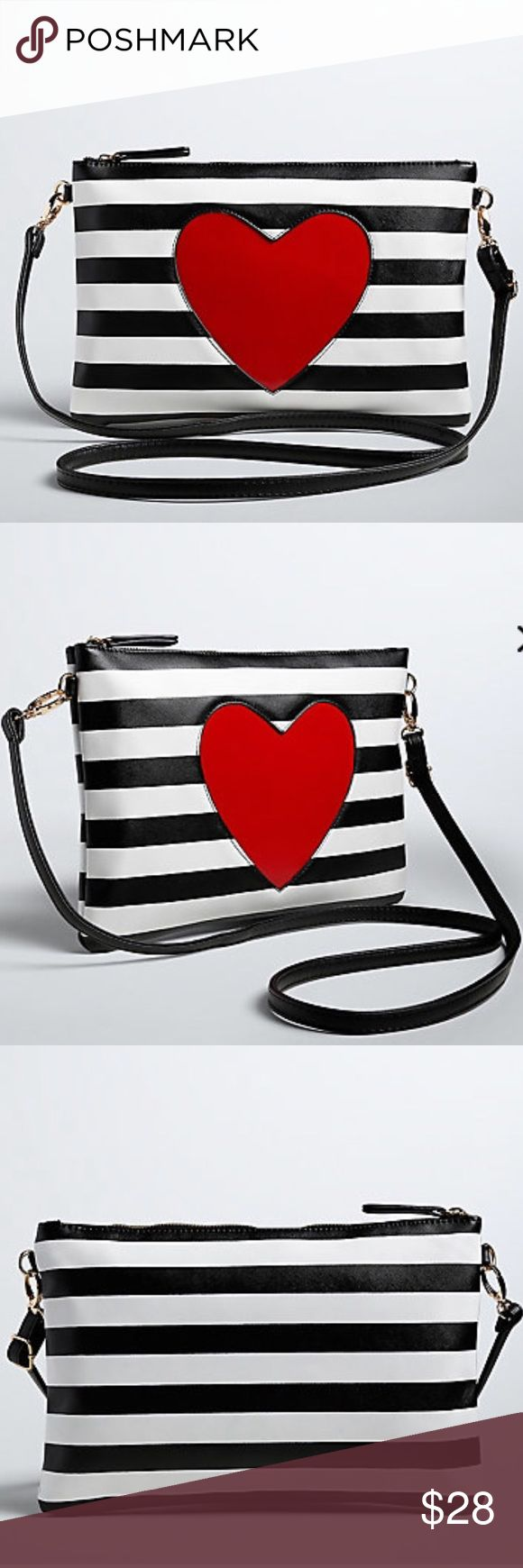 Torrid Striped Clutch Torrid Striped Faux Leather Clutch with Vinyl Heart. Zip Top with Inside Zippered Pocket and Two Inside Slit Pockets. Long Detachable Strap. Brand New, With Tags. Torrid Bags Clutches & Wristlets