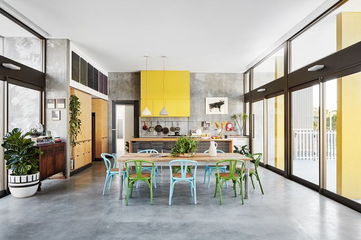 Concrete, Carrara marble, Laminex and pine all combine to create an open-plan kitchen and dining in this newly-built family home in Perth. Photography: Jack Lovel | Stylist: Anna Flanders | Story: Australian House & Garden