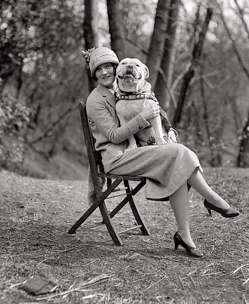 April 14, 1925. Washington, D.C. Miss Mae Esterly with Sgt. Jiggs. Pibble Staffie