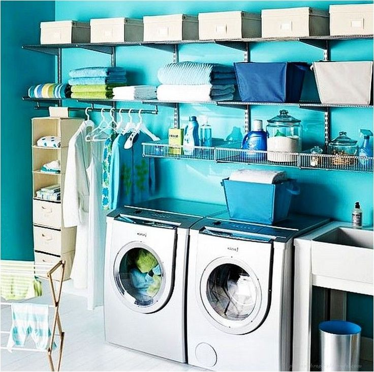 sparkling light blue laundry room design with wall shelves