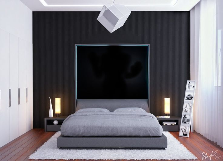Black Feature Wall Design And Grey Platform Bed Unit With Two Yellow Lamp Shades Above Bedside