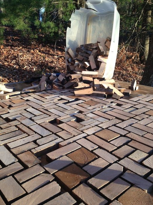 "DIYers made a surprising floor by cutting wood plank into ""bricks and cementing them down."
