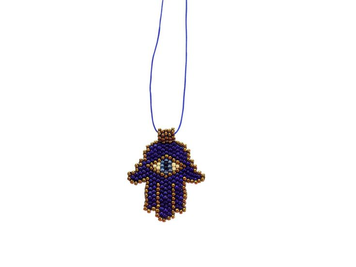 Long handcrafted necklace made with beads approximately 2 mm in one last string.  Depicting the open right hand of Fatima, an image recognized and used as a sign of protection in many societies throughout history, the hamsa is believed to provide defense against the evil eye.