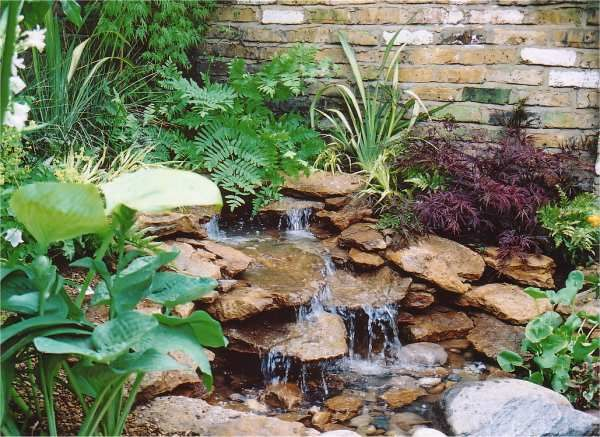 Informal garden style used to create a natural looking small pond