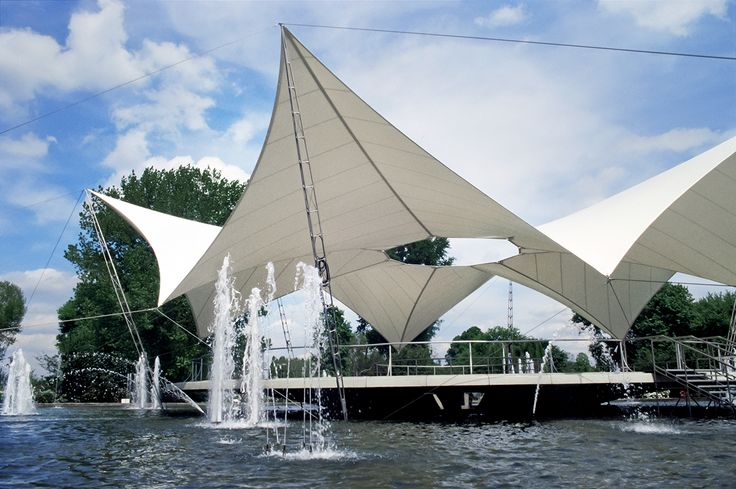 "The Starwave tent is a classic of minimal surface structures based on the model of soap films. Frei Otto designed and built this tent to cover a dance floor in the center of a circular Fountain, the so-called dance fountain during the garden festival in Cologne 1957. In 2001 we replaced the cotton sailcloth with a polyes-ter fabric. The ""Tanzbrunnen"" has become a popular institution and it is hard to imagine Cologne without it."
