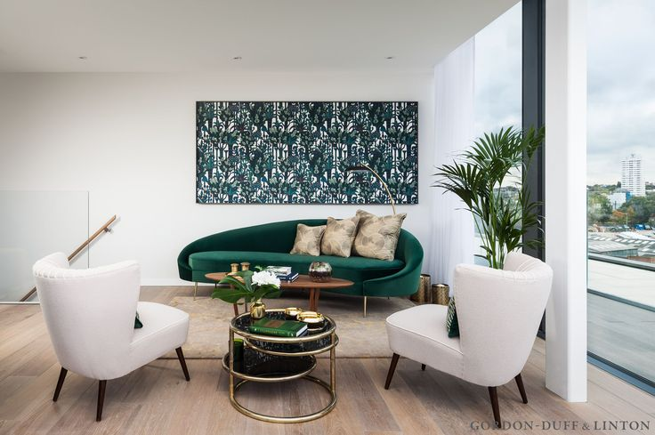 Winter garden in the penthouse featuring framed Hermes wallpaper, curved emerald green velvet sofa and two vintage chairs which we recovered. We also commissioned the cushions. #GD&LBespokeFurniture