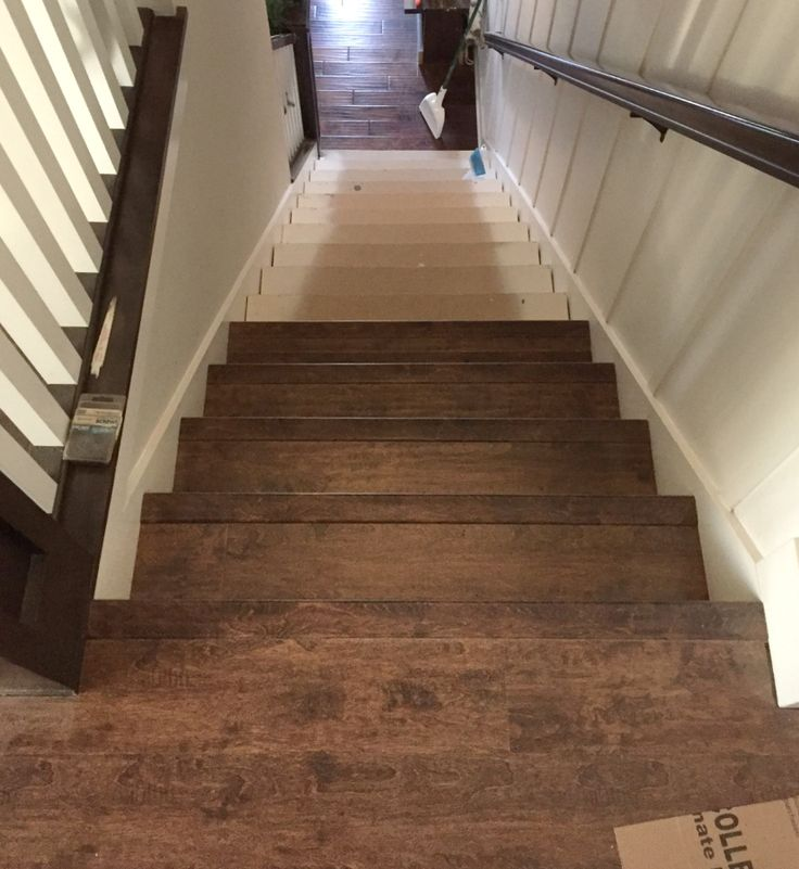 DIY replacing carpeted stairs with laminate flooring.
