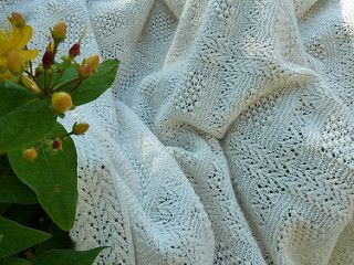 Square Baby Blanket or Shawl, in a pattern of Trinity Stitch surrounded by Garter Stitch and Arrowhead lace.