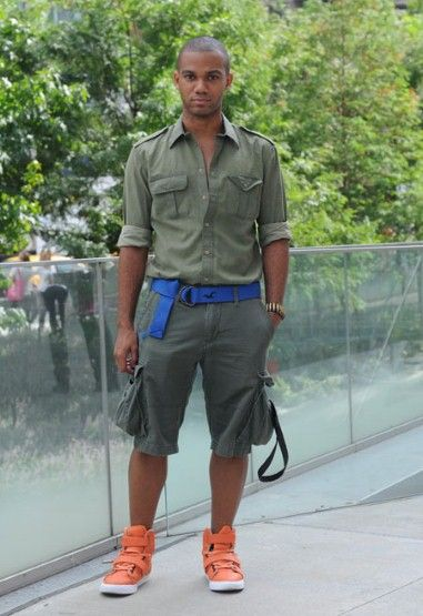 Khaki and orange - punctuated with bold blue -  Safari look. Picture: BRIDGET FLEMING/ SHOWMODA.COM. I love this look, but DITCH the orange and the blue! Shirt and shorts are a winner though.