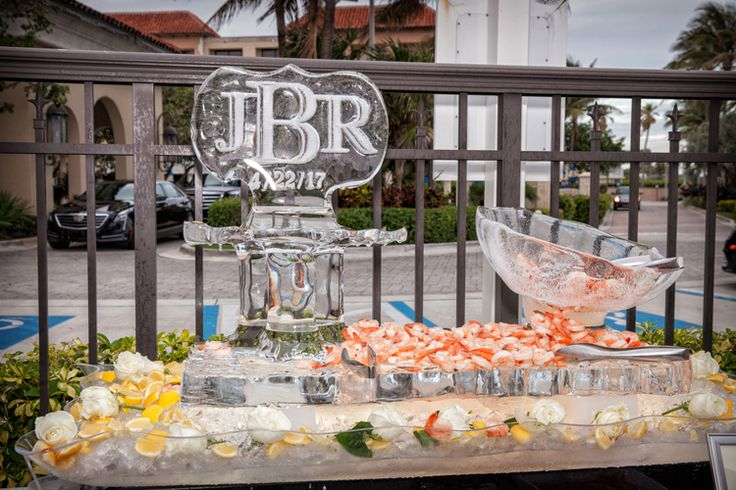 Obsessed with this cocktail hour idea! A monogrammed ice bar with shrimp (Jeff Kolodny Photography)