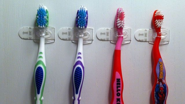 "Use command hook(s) to mount toothbrushes.  Pinterest user Kelly N Jared Stover says: ""I used the small clear 3M Command hooks turned sideways on the inside of my medicine cabinet to s..."