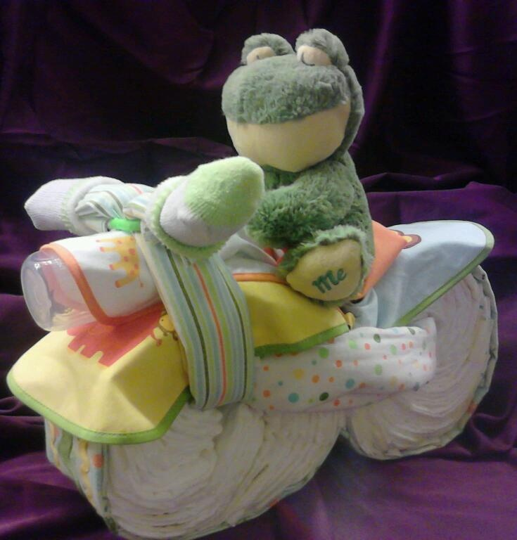 Finished diaper cycle, the frog plays Jesus Loves me when you squeeze its stomach! It took 4 blankets, 50 diapers, 4 bibs, a pair of baby socks and a bottle to make this cute thing!