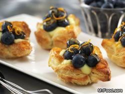 Mini tarts are in hot demand! Our yummy spring recipe for Mini Blueberry Tarts are made by filling mini puff pastry cups with a sweet custard and topped with field-fresh blueberries, for a spring dessert treat everyone will love.