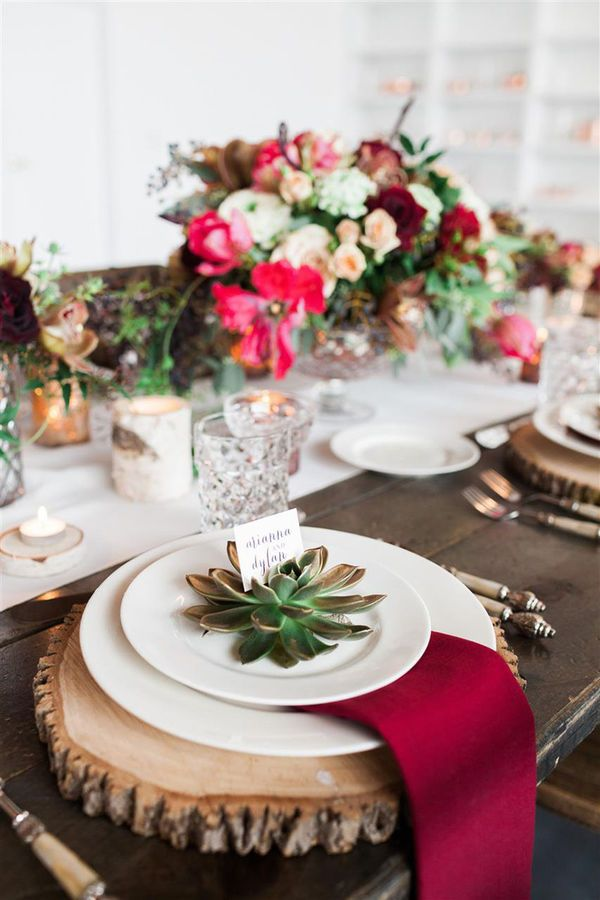 Using woodcuts on tables has been a popular trend for several seasons. But this tablescape with its woodcut chargers and birch candleholders shows just how pretty a fall table can be with just a few woodsy elements.