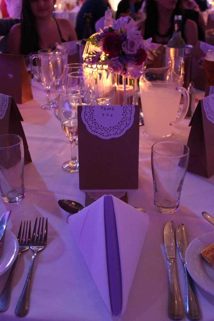 Our wedding favours were candle melts in brown paper bags with doilies that were hand stamped. Centrepieces were bird cages with candles & floral arrangements