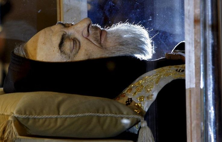 The body of one of the most popular Roman Catholic saints, the mystic monk Padre Pio, began an overland journey in a crystal coffin on Wednesday to go on display at the Vatican.