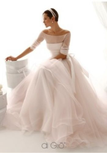 A sleek up-do and an Audrey Hepburn-esque neckline perfectly balance the yards of tulle in the full skirt of this Le Spose di Gio gown. San Francisco Designer Wedding Gown Collection Joan Gilbert Bride