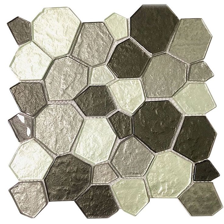 The depth of these 11.5-inch Glass Mosaic Wall Tiles, along with its metallic tones creates a 3D waterfall effect in your wall. Just peel and stick and you can enhance your kitchen, bathroom or accent walls.