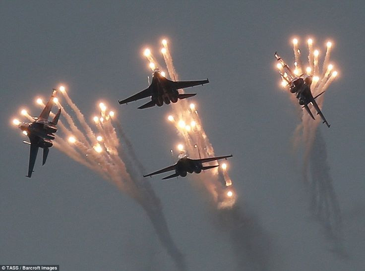 Sukhoi Su 27 fighter jets from the Russkiye Vityazi (Russian knights) aerobatic teamshowing off their accuracy as they flew in perfect symmetry