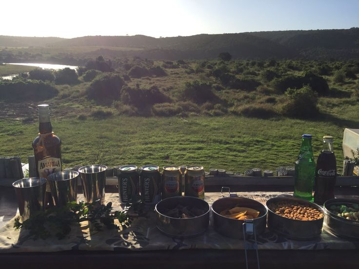 Sundowners and snacks set up for the guests at Sibuya River Camp overlooking the Kariega River and bush. Kenton on Sea, Eastern Cape, South Africa www.sibuya.co.za